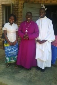 Mauel-ordaining-his-first-priest-Padre-Maruicio-201x300