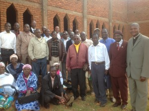Revd Vicente Msossa with some of congregation of Bairro Popular church