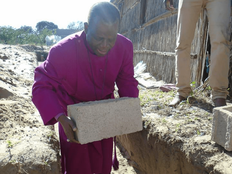 Bishop laying the cornerstone for a new church in Mozambique