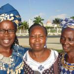 Three Angolan ladies smiling at the camera