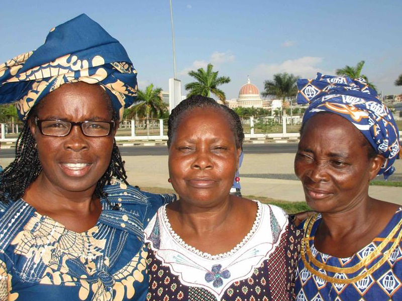 Three Angolan ladies smiling at the camera